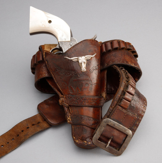 """Unique, vintage leather Cartridge Belt and double loop, tooled Holster for a Colt, 4 3/4"""" revolver."""