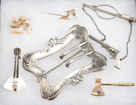 A collection of six antique items to include: Gold and mother of pearl Stick Pins, two silver & gold