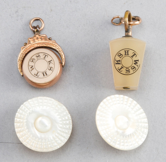 Four piece antique collection to include:  Gold and mother of pearl, round Watch Fob, lantern shaped