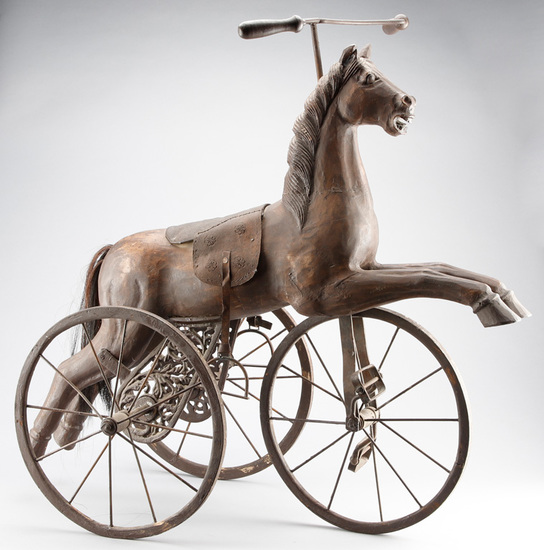 Very unique Wooden Horse Tricycle with horse hair tail and ornate wheel brackets, leather saddle, ir