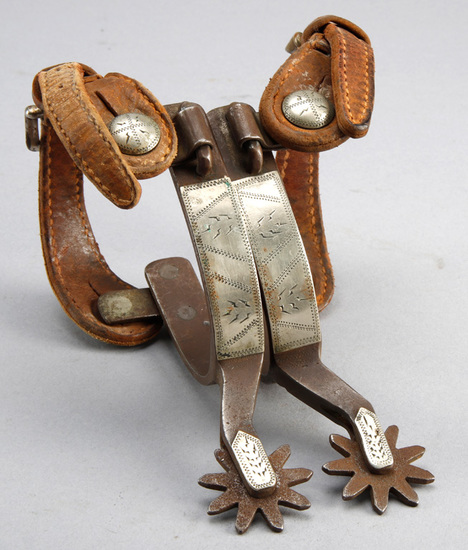 "Pair of ""Kelly"" marked single mounted Spurs, hand engraved silver overlay, sold with vintage two pie"