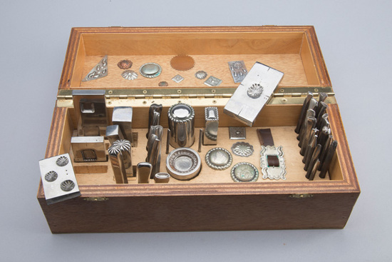 Wooden cased Silversmith Tooling Set with 34 tools for stamping rosettes for buckles or saddles.  NO