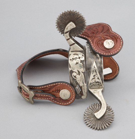 Fancy pair of double mounted, silver engraved, overlaid Spurs (#613), by Texas Bit and Spurmaker Cli