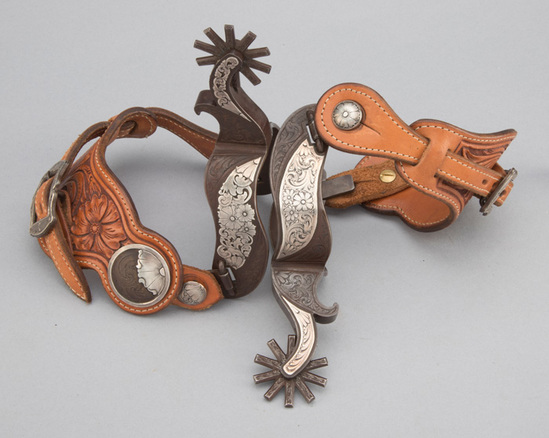 Very unique pair of double mounted, hand engraved, silver mounted Spurs by well known Texas Bit and