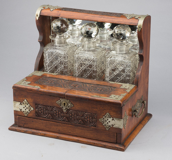 Elaborate, antique oak case Tantalus,(Liquor Bar), with German silver trim, three crystal Decanters