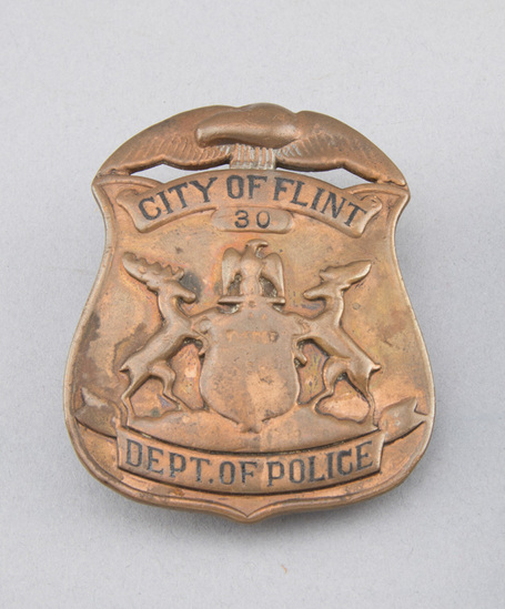 """City of Flint, #30, Dept. of Police Badge, brass shield with eagle crest, 2 1/2"""" T.  George Jackson"""