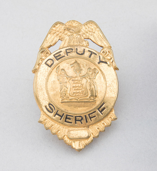 """Deputy Sheriff Badge, shield with eagle crest, 2 3/4"""" T, gold plate.  George Jackson Collection."""