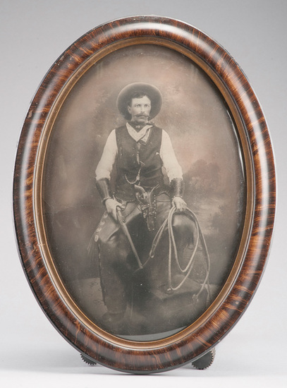 Very desirable oval, bubble glass framed vintage Photograph of an early cowboy in all his gear, circ