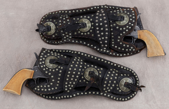 "Scarce, matching pair of early ""R.T. Frazier"" marked, spotted double loop Holsters with matching con"