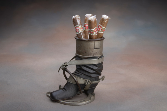 Scarce antique metal table top Cigar Stand, circa 1900, in shape of a boot with spur mounted on hors