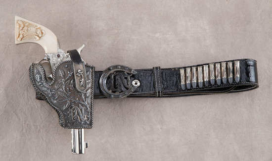Unique leather Holster and Belt Rig.  Holster is covered with silver, with matching snap and buckle.