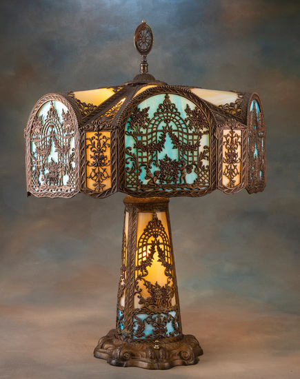 "Outstanding antique, bent panel, multi-color stained glass Table Lamp marked ""Miller Co."", circa 192"
