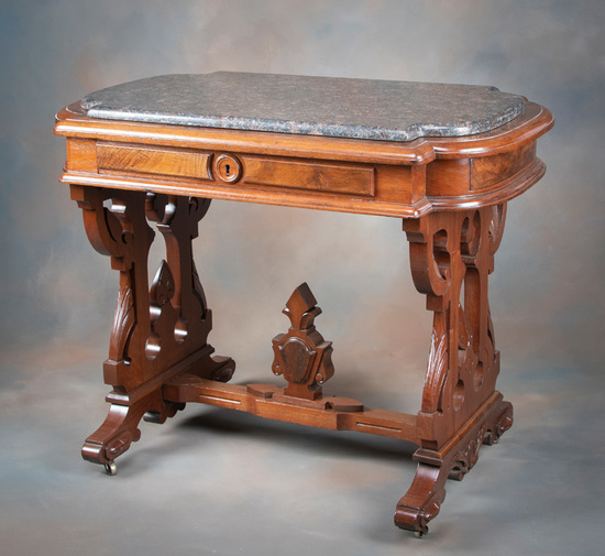 Antique Victorian Walnut, marble top Parlor Table, circa 1880s, with finial stretcher and drawered s