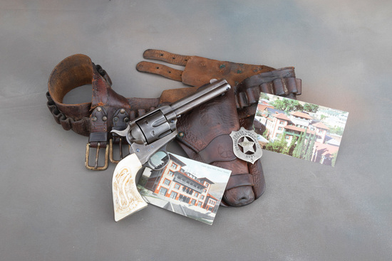 An historical Arizona Territory shipped Colt SAA Revolver with carved pearl grips and Holster Rig.