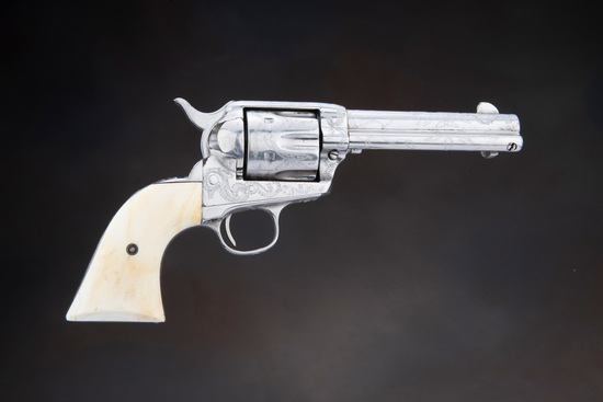 "Antique engraved Colt SAA Revolver, .45 Colt caliber with 4 3/4"" barrel and ivory grips, manufacture"