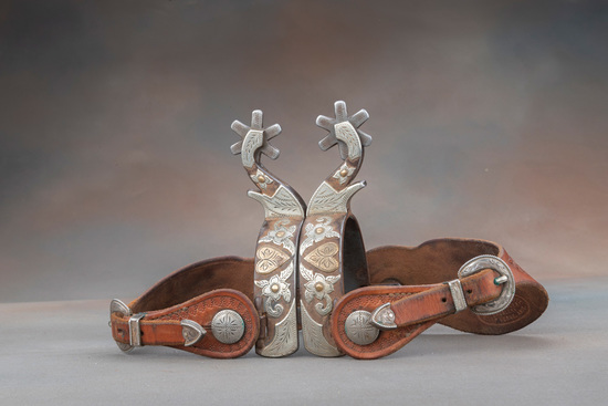 A pair of double mounted Spurs by Texas Bit and Spur Maker Kevin Burns in floral and heart pattern o