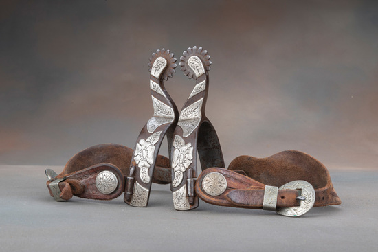 A pair of double mounted silver hand engraved Spurs by noted Texas Bit and Spur Maker the late Jerry