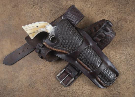 "Nice condition, basket weave Cartridge Belt & double loop Holster.  Belt is marked ""Eubanks Leather,"
