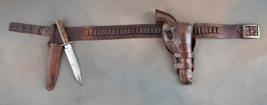 Matching, three piece Holster, Cartridge Belt, Sheath and matching Side Knife.  All leather has the