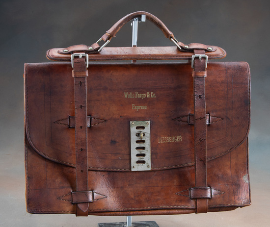 """Heavy leather Messenger Pouch marked in gold """"WELLS FARGO & CO., EXPRESS MESSENGER"""", measures 17"""" wi"""