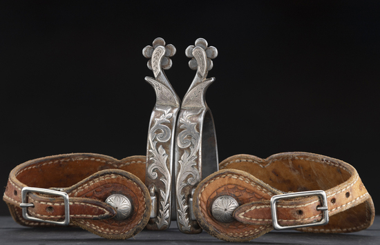 "Unique pair of ""Earlon Shirley"" marked single mounted Spurs, #258, heavy silver overlay on heel band"