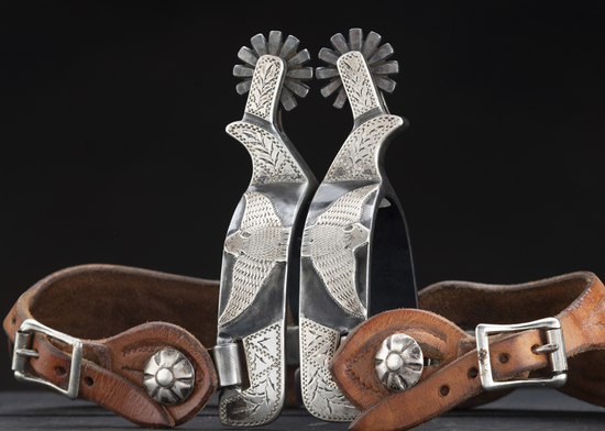 Fine pair of single mounted Spurs by noted Texas Bit and Spur Maker Ray Anderson, #1042, heavy silve