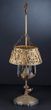 Most unusual antique Table Lamp with metal figural shade and silk liner, ci