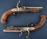 A beautiful matched pair of Flintlock Belt Pistols by famous firearms maker