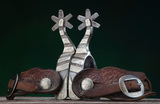 A pair of single mounted Spurs by noted Pampa, Texas Bit and Spur Maker Bil