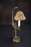 Most unusual antique brass, Table Lamp with turkey foot base and ornate fil