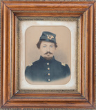 Framed, hand tinted Photograph of Civil War Soldier in uniform in a magnifi