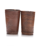 A pair of floral tooled Roping Cuffs, stamped