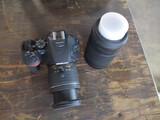 Nikon D5600 18-55 mm lens, 70-300 mm lens, 2 batteries, charger & bag.
