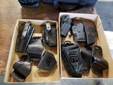 2 boxes of holsters