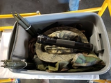 Tub of camo clothing, tent poles, mag lite, misc