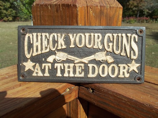 Cast Iron Please Check Your Guns At The Door Sign Plaque