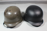 Lot of 2 German Combat Helmets.  1 Reproduction. 1 Possible Foreign Issue.