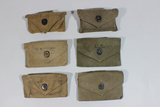 Lot of 6 US WW2 First Aid Bandage Pouches. Some W/ Contents.