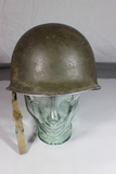 US WW2 Front Seam Fixed Bale M1 Helmet W/ Liner. Some Damage.
