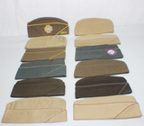 Lot of 12 US WW2 Overseas Garrison Caps. Some Khaki, some later, and some OD.