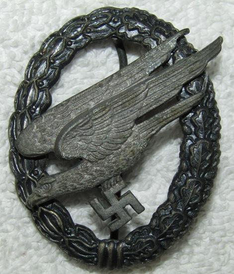 Scarce Late War Injection Molded Fallschirmjager Badge- L/64 Assmann