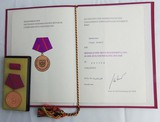 DDR East German 1986 Civil Defense Medal in Bronze/Ribbon Bar/Award Document/Presentation Folder