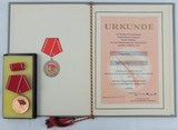 DDR East German Kampfgruppen der Arbeiterklass Medal for Excellent Achievements Award Grouping