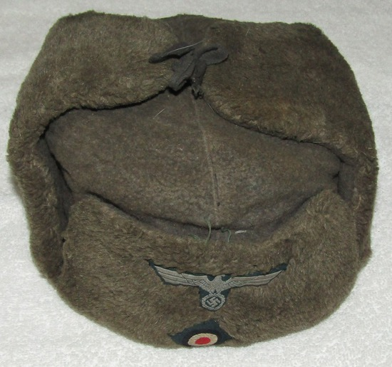 WW2 Period Russian Ushanka Wool Winter Cap With Enlisted Heer Insignia.