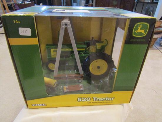709. Ertl John Deere 520 Restoration Tractor with Accessories in Box