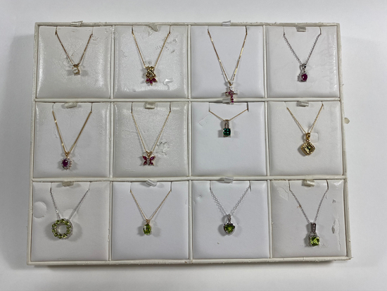Necklaces on various chains. Estimated Retail Value of $2,370.00 for all 12 necklaces.