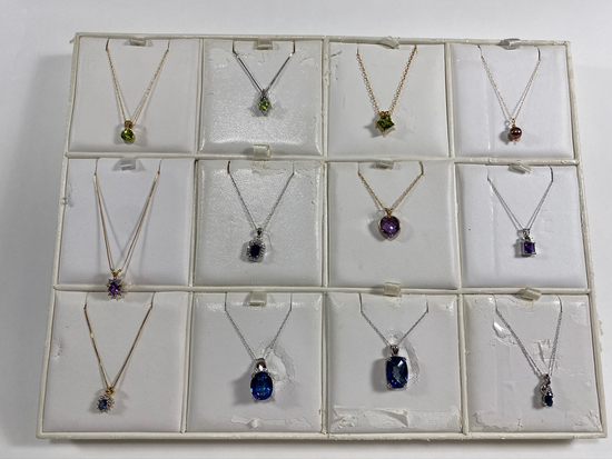 Necklaces on various chains. Estimated Retail Value of $2,150.00 for all 12 necklaces.