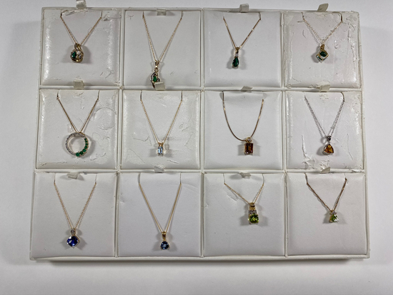 Necklaces on various chains. Estimated Retail Value of $2,045.00 for all 12 necklaces.