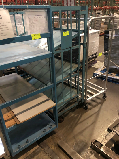 ID#: Back wall  2 blue push carts (1 with 3 slanted shelves, 1 with 3 flat shelves) and 1 metal push