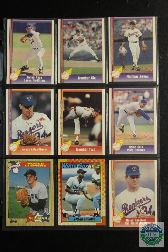 Sheets of collectible baseball and sports cards